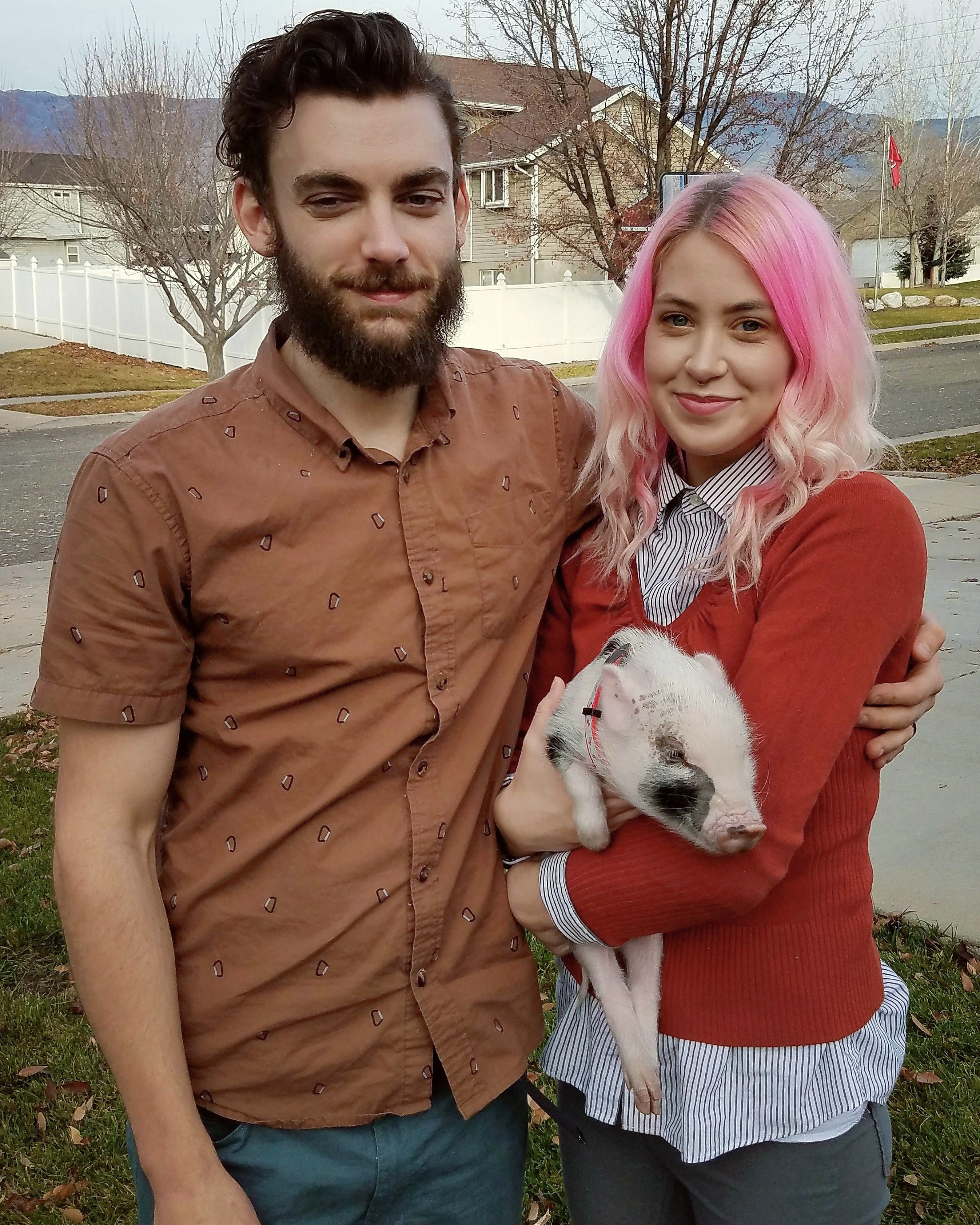 Miranda, her fiance, and their piglet